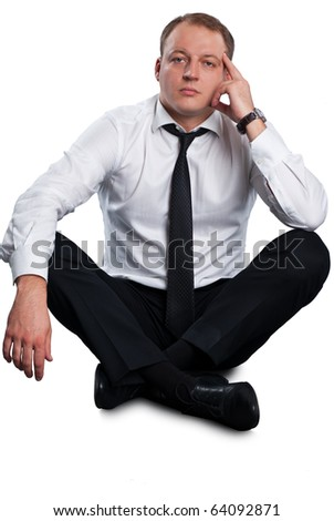 Businessman sitting on the floor and thinking. Isolated on white background. - stock photo