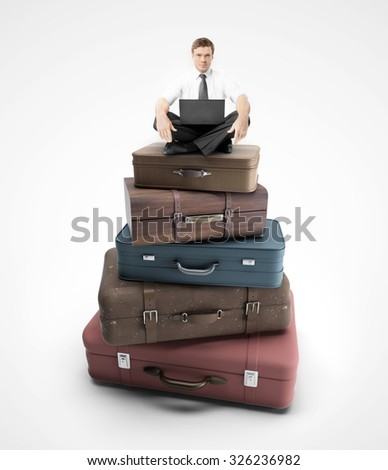 businessman sitting on travel bags - stock photo