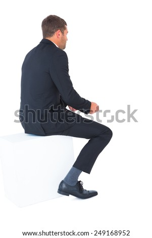 Businessman sitting put his hands front on white background