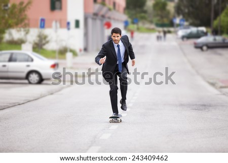 Businessman skateboarding - stock photo