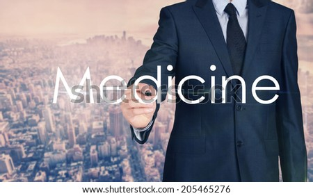 Businessman sketching and writing Medicine with nice business city background in retro colors. - stock photo