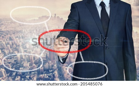Businessman sketching and writing some graph with nice business city background in retro colors. - stock photo