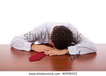 Businessman sleeping at the office (isolated on white) - stock photo