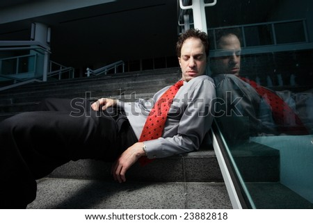 Businessman sleeping on a staircase