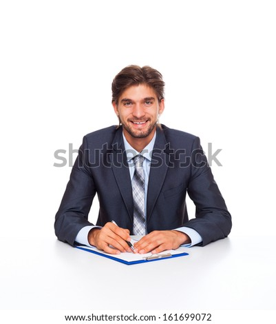 businessman smile at office desk sign up contract, Handsome young business man sitting with documents, papers, handwriting isolated over white background - stock photo