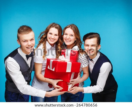 Businessman smile present gift red box in hand. With big group of Business people on background - stock photo