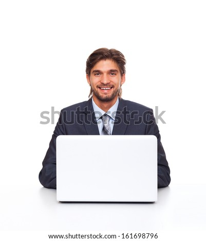 businessman smile working using laptop computer, handsome young businessman sitting at the desk wear elegant suit, isolated over white background - stock photo