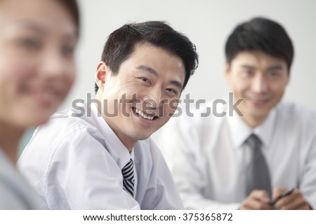 Businessman Smiling At Camera - stock photo