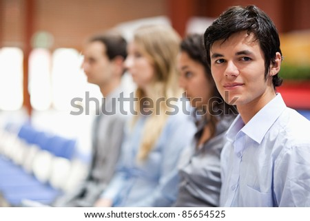Businessman smiling at the camera during a presentation - stock photo