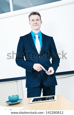 Businessman smiling confident at conference room