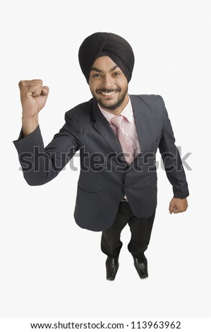 Businessman smiling with his hand raised - stock photo