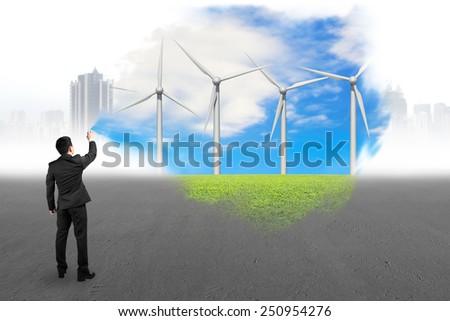 Businessman spraying wind turbines paint covered gray cityscape concrete floor background - stock photo