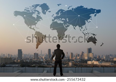 businessman stand on roof top of skyscraper, business globalization concept - stock photo