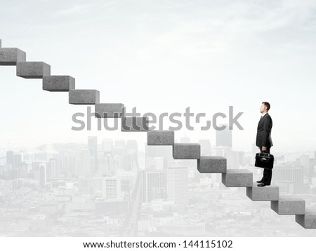 Businessman standing a staircase and city