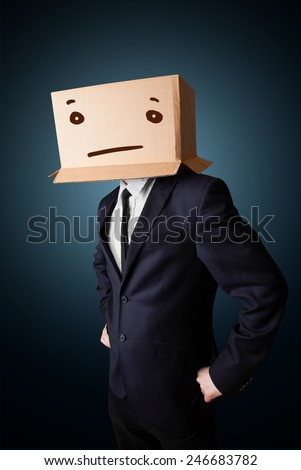 Businessman standing and gesturing with a cardboard box on his head with straight face - stock photo