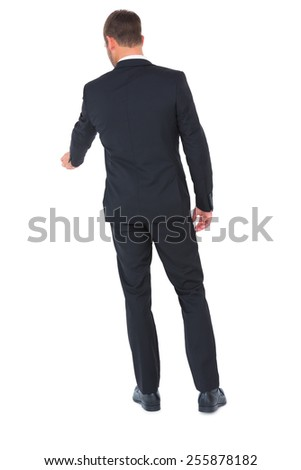 Businessman standing and looking down on white background