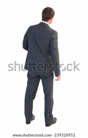 Businessman standing and looking on white background