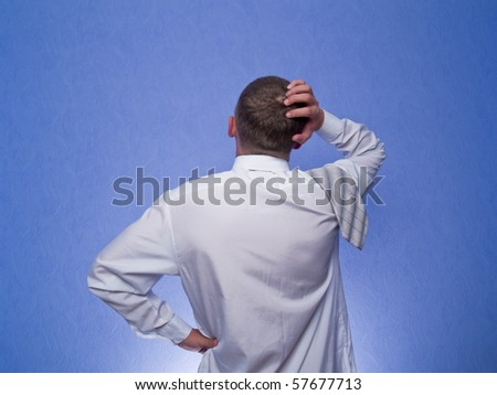 businessman standing and thinking - stock photo