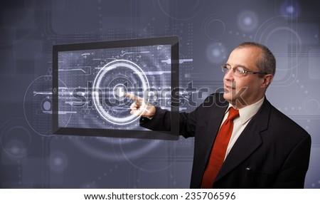 Businessman standing and touching modern technology tablet - stock photo