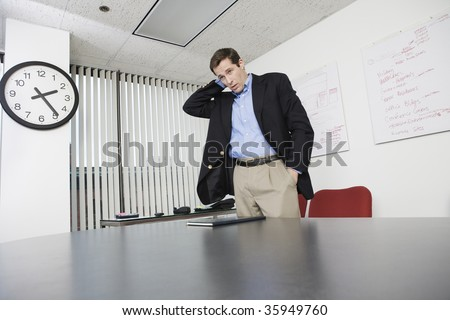 Businessman standing and waiting in an office.