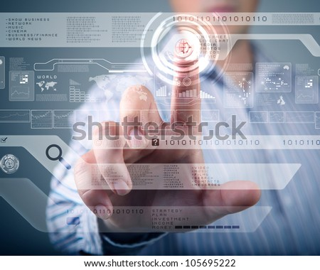 Businessman standing and working wth touch screen technology - stock photo