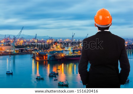 Businessman standing at a port of its own. - stock photo
