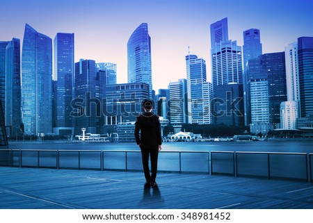 Businessman standing at night cityscape, Business vision concept - stock photo