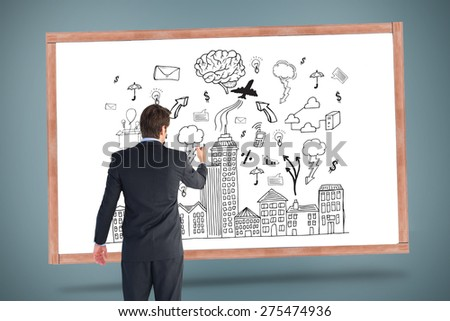 Businessman standing back to camera writing with marker against cityscape with brainstorm - stock photo