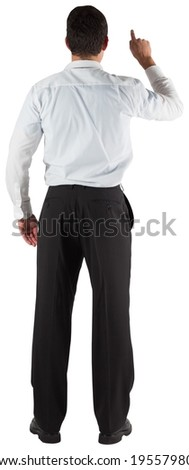 Businessman standing back to the camera pointing on white background