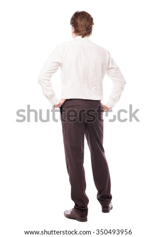 businessman standing back with arms at hips over white background  - stock photo