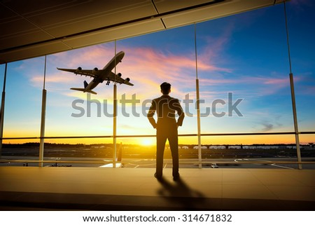 Businessman standing in airport - stock photo