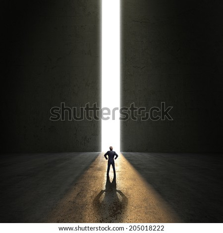 businessman standing in front of a portal - stock photo