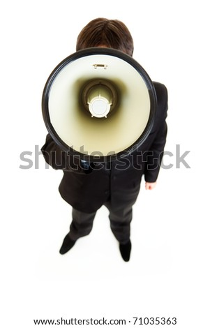 Businessman standing in front of camera and speaking into megaphone isolated on white