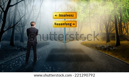 "businessman standing on a crossroad with the signs ""bankruptcy"" and ""new start"" in German - stock photo"