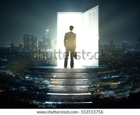 Businessman standing on abstract illuminated night city steps with open door and bright light. Success concept. Double exposure