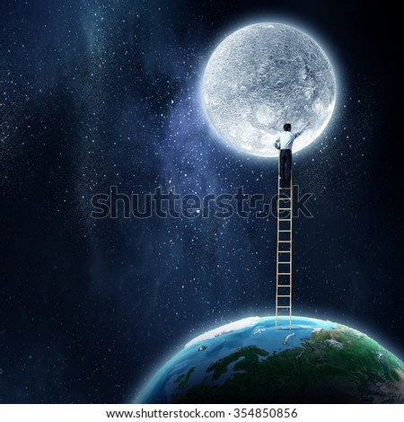 Businessman standing on ladder between moon and Earth palnet. Elements of this image are furnished by NASA - stock photo