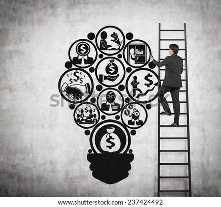 businessman standing on ladder drawing symbol in form lamp - stock photo