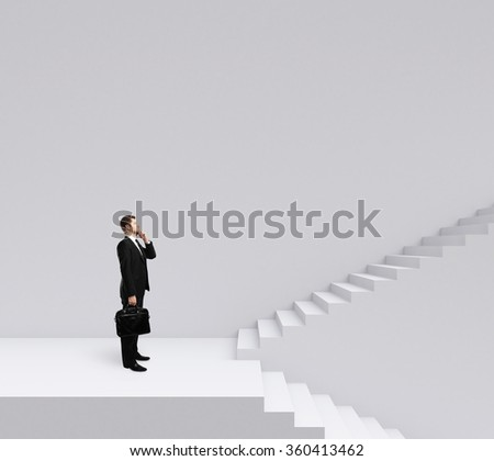 businessman standing on stairs on a gray background