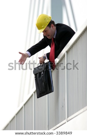 Businessman standing on the bridge and yelling - stock photo