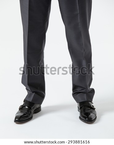 Businessman standing on the floor - closeup of legs - stock photo