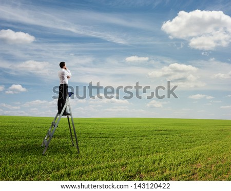 businessman standing on the pair of steps and thinking - stock photo
