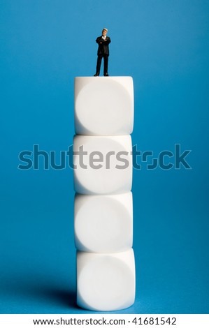 businessman standing on top of a pile of white cubes - stock photo