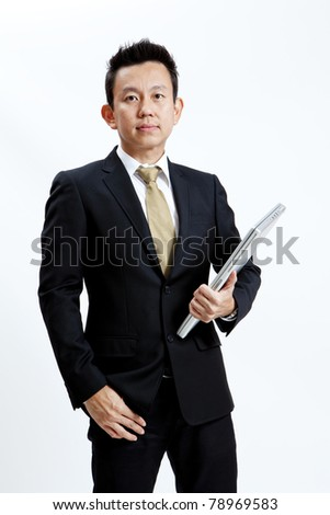 Businessman standing on white background - stock photo