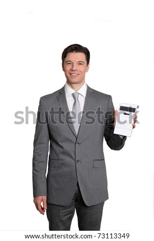 Businessman standing on white background with calculator - stock photo