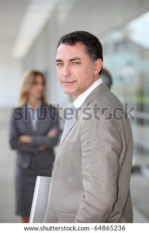 Businessman standing outside modern building