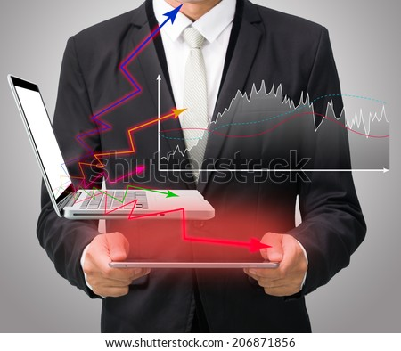 Businessman standing posture hand hold graph on tablet isolated on gray background - stock photo