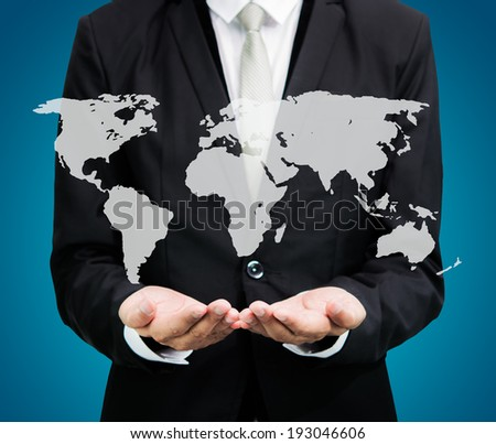 Businessman standing posture hand holding Earth icon isolated on over blue background - stock photo