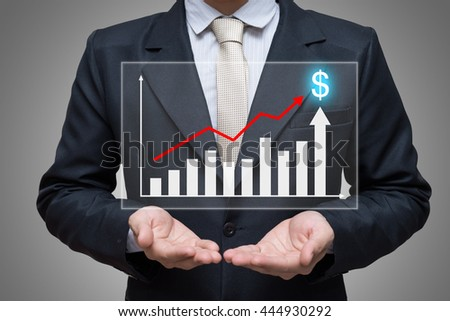 Businessman standing posture hand holding graph finance isolated on gray background - stock photo