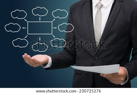 Businessman standing posture hand holding strategy flowchart isolated on dark background