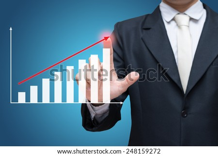 Businessman standing posture hand touch graph finance isolated on over blue background - stock photo